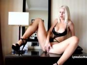 Lovely blonde babe Lynna teases herself in her hotel room
