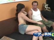 Beautiful young brunette gets down on her knees and sucks his cock