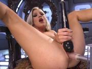 Beautiful blonde in high heels fucks machine