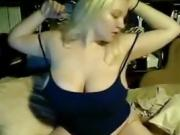 Busty blonde does a hot number