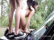 Lesbians toying on the bonnet of cab
