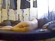 girl masturbates with a vibrator on her bed and squirms of joy