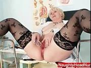 Huge boobies older madam in uniform masturbates bushy vag