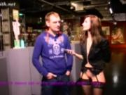 Jeny Smith bottomless interviews a guy at museum of erotic and sex.