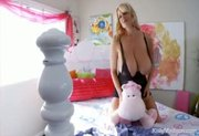 Kelly Madison Having Fun With Her Giant Natural Titties On Her Be
