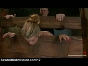 Blonde immobilized in the wall stockade and whipped and vibed