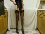 Tranny in basque and stockings jerks for you