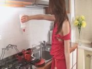 Brunette chick doing the dishes