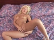 Hot blonde playing with her pussy
