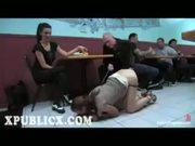 Leashed brunette spanked in restaurant