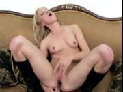 Petite blonde cutie Jewles masturbates on the couch in knee high boots