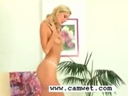 Skinny tight blonde masturbates in sheer pink stockings and high heels