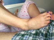 Cute amateur girl gives her man a footjob until he cums