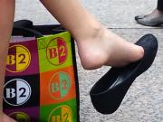 Girl Relaxes, Twirling Around Her Shoe While Her Feet Are Filmed By Hidden Camera