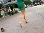 Voyeur following sexy backless peeptoe pumps