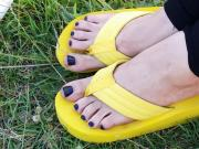Cute feet in thick foam flip flops