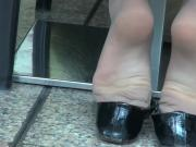 Candid dangling at shopping mall in stockings