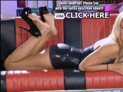 Sexy Blonde Woman Wearing HIgh Heals Chats On The Phone While Twirling Her Feet Around