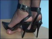 Pointy heels crushing cock until orgasm