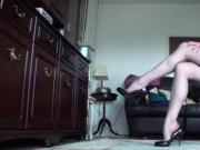 Older woman in stockings and garter belt