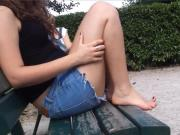 Cute Young Girl In Short Shorts Get Her Feet Unsuspectingly Filmed On Park Bench