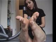 Toes getting sucked by vacuum cleaner