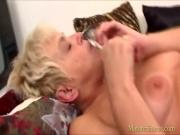 Old blonde lady plays with plastic toy
