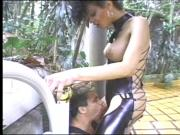 Tranny in latex fucked by her slave and takes facial