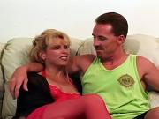 Mature c-cup blonde in red stockings bends over for doggy-style fuck