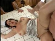 Horny brunette gets slammed hard from behind while sucking on a large dick