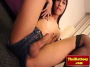 Young thai tgirl in stockings plays with self