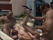Sexy blonde in black fishnet top gives head and gets fucked by three guys