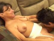 Dyke commands midget to eat her pussy while she lays back on couch