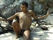 Horny little Asian guy jacks off on the beach by himself