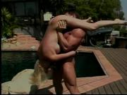 Beautiful blonde with awesome body fucks musclehead on pool deck
