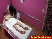 Tattooed asian masseuse tugging client