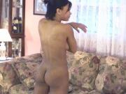 Cute little black chick shows off her skinny beautiful bod on a couch
