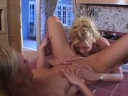 Young blonde babe fingers and licks a wet pussy in the kitchen