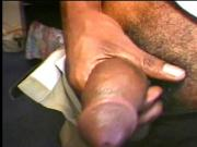 Erotic black gay dude in pleasure as he jerks off his huge hard dick