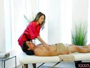 Cute masseuse pounded by her client on massage table